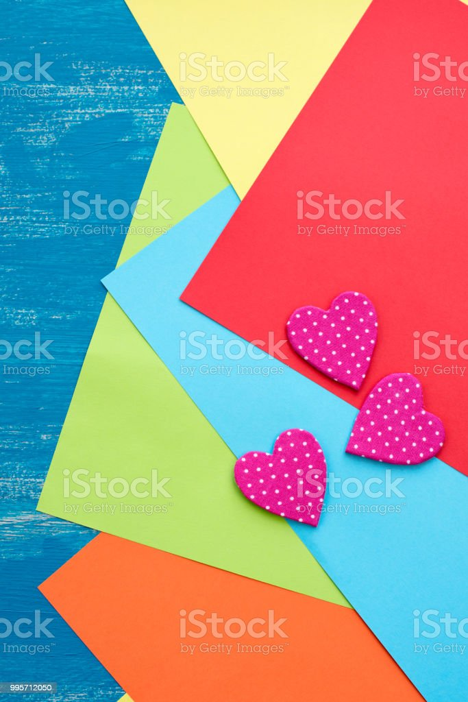 Colored Sheets Of Paper On A Wooden Painted Blue Background ...