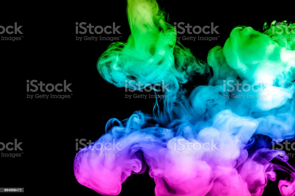 colored smoke isolated on a black background. fractal. spiral. stock photo