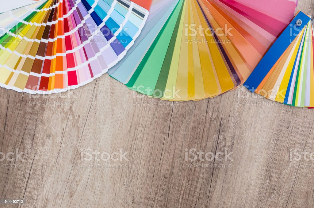 Colored specimens lie on a wooden table stock photo