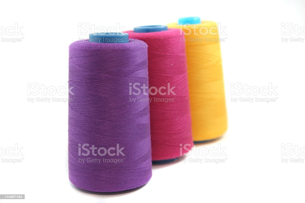 colored spools of thread isolated royalty-free stock photo