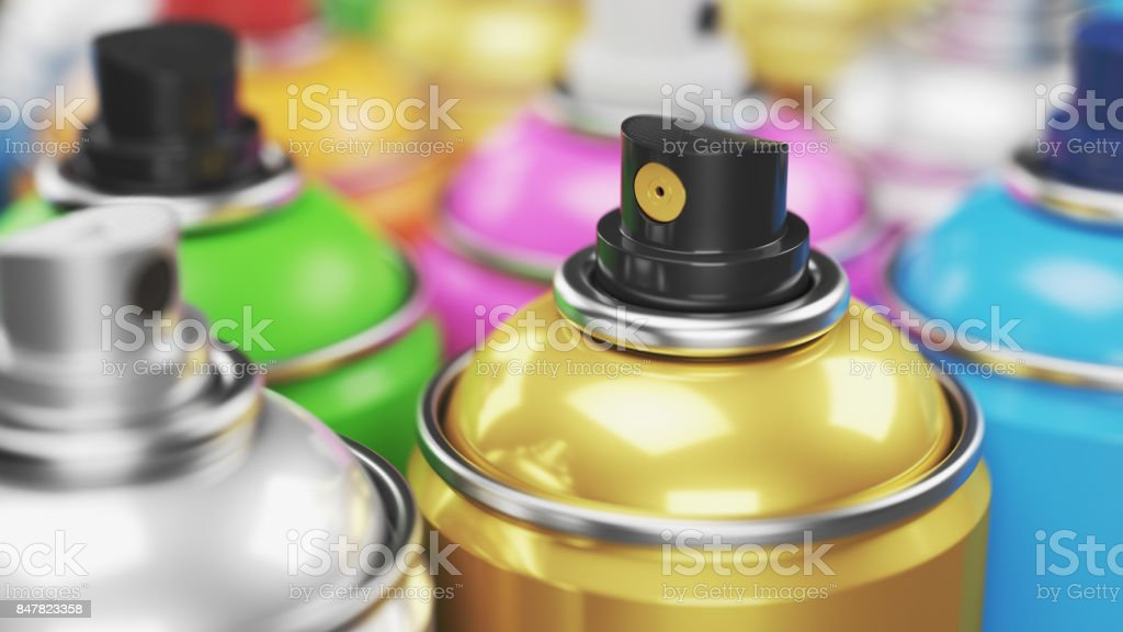 Colored spray paint cans closeup. stock photo