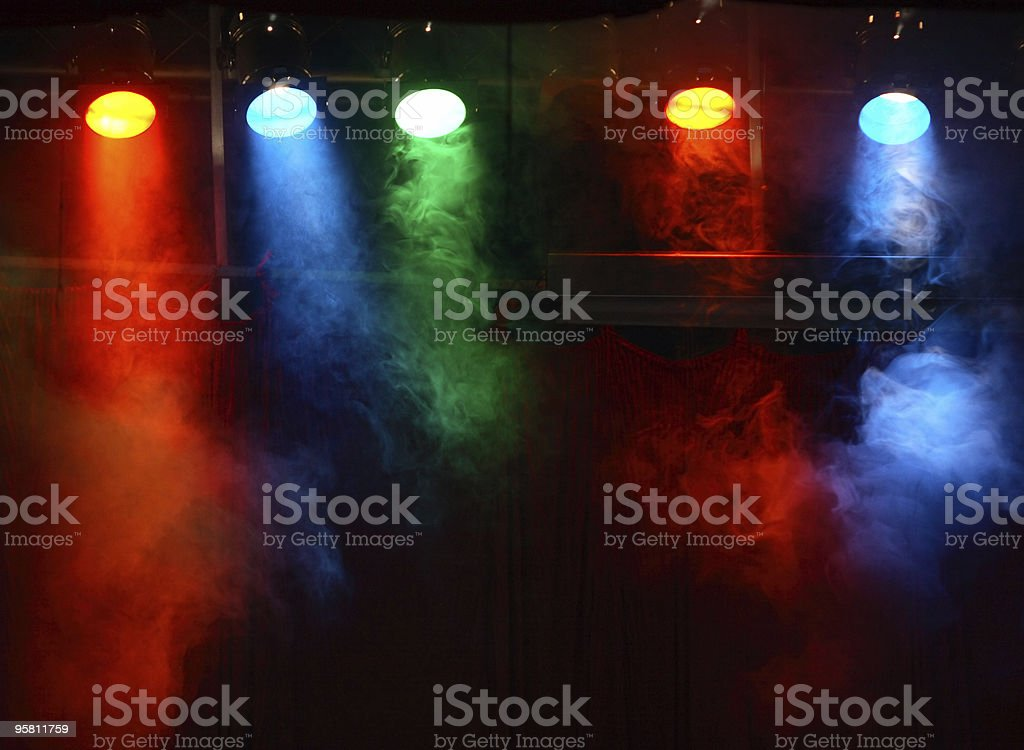Colored stage lights with artificial fog royalty-free stock photo