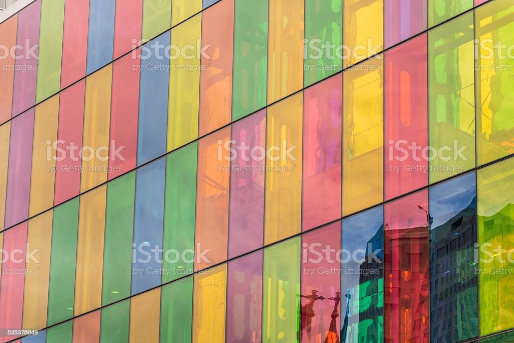 Colored stained glass with church crosses reflections on it stock photo