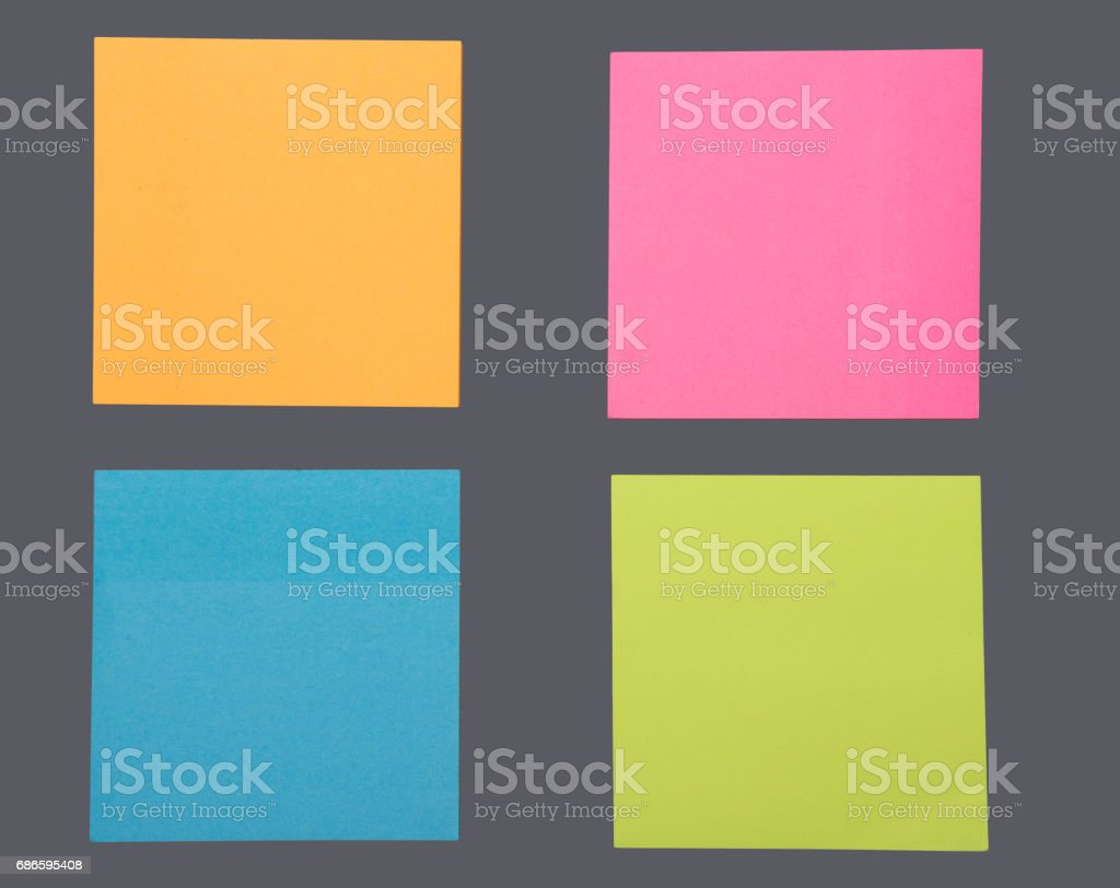 colored sticky notes on grey background royalty-free stock photo
