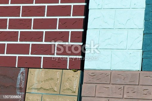 colored stone texture of bricks and paving tiles on an advertising stand
