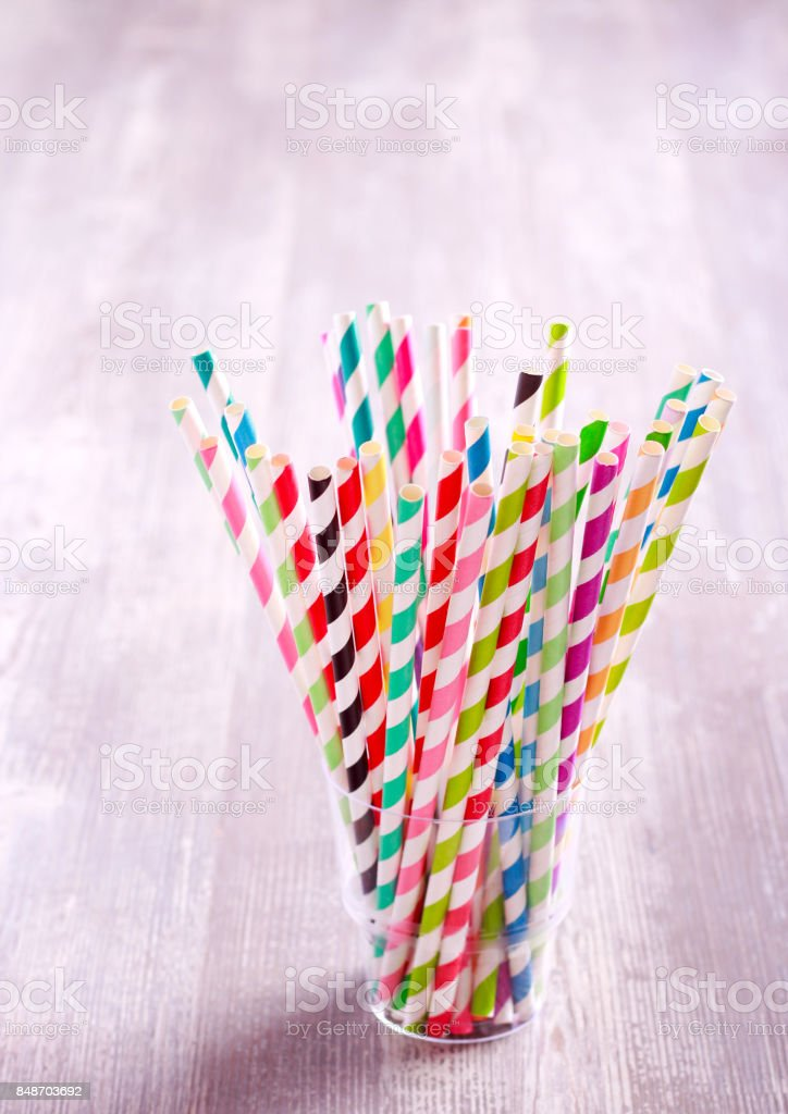 Colored Striped Drink Straws In Glass Stock Photo - Download