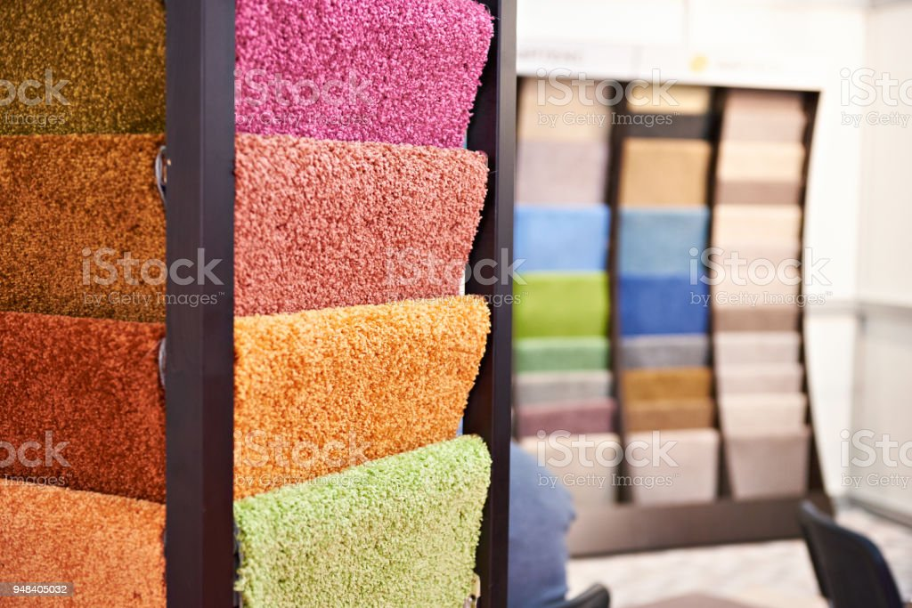 Colored synthetic soft fleecy flooring in store stock photo