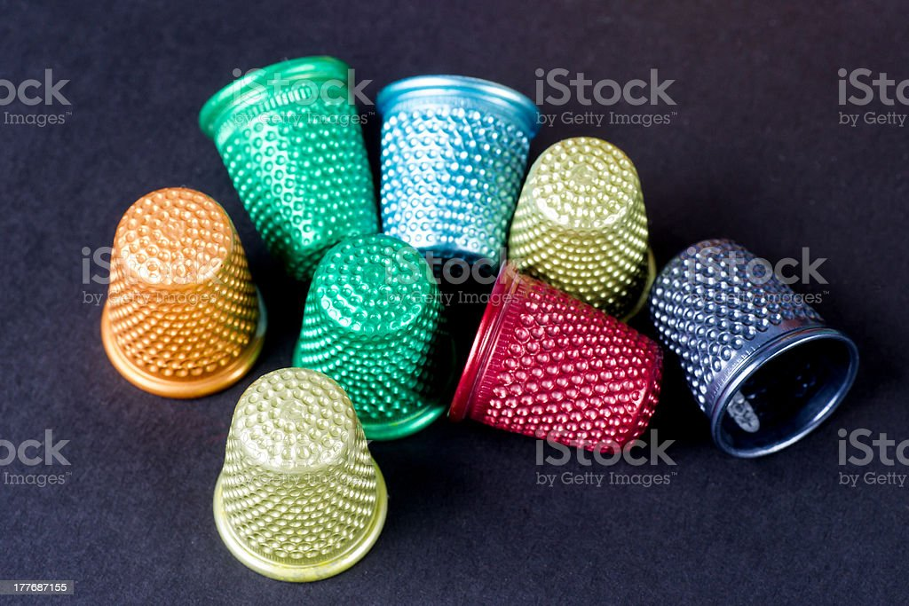 Colored Thimbles Isolated on Black Texture royalty-free stock photo