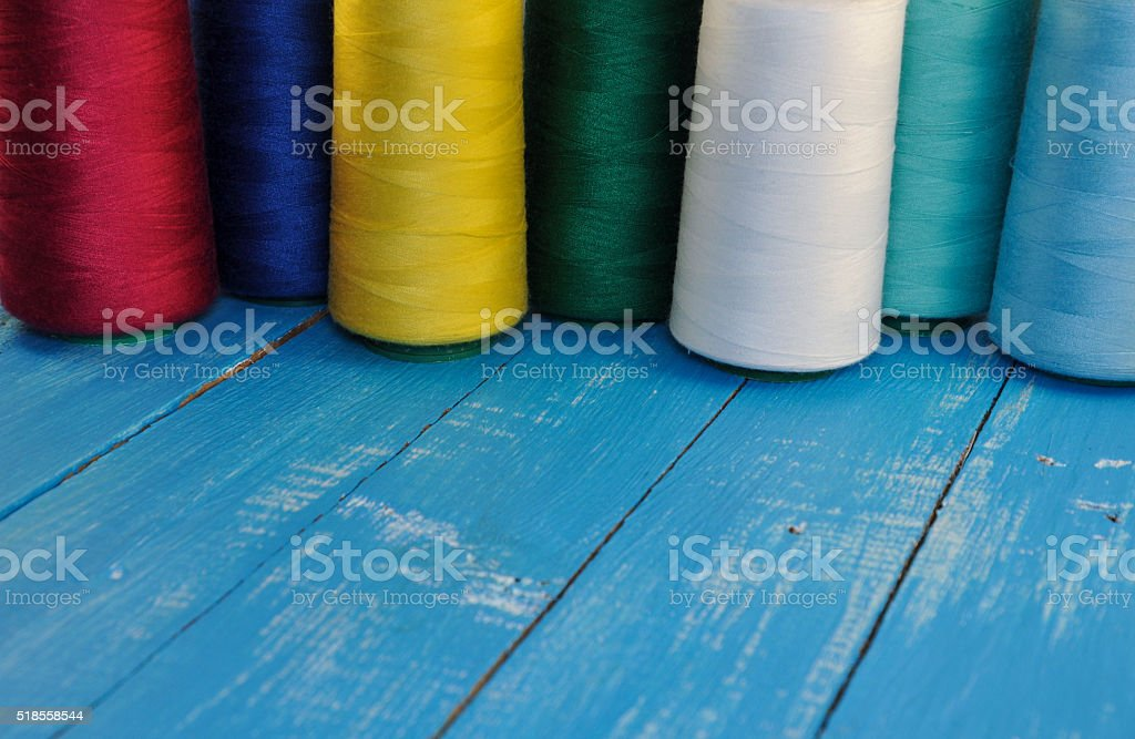 colored threads for sewing and embroidery stock photo