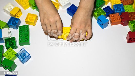 873187696 istock photo colored toy bricks on the floor 1176652739