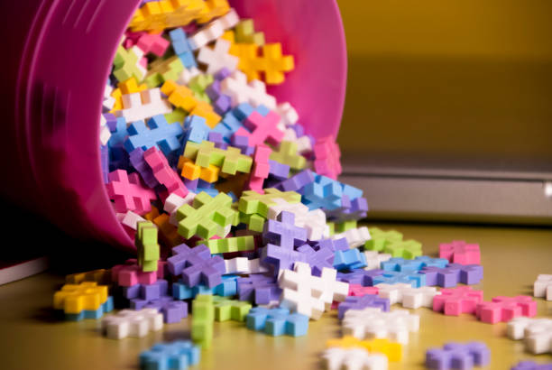Colored toy constructions that come out of a container - foto stock