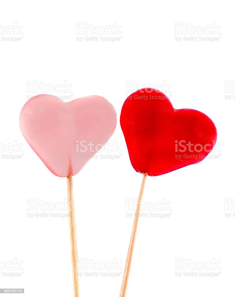 Colored transparent heart shape jellies in wooden sticks royalty-free stock photo