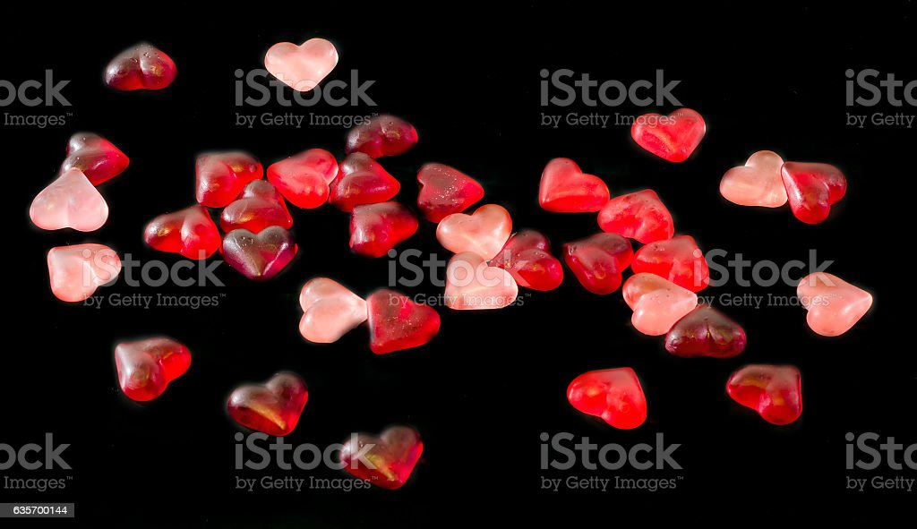 Colored (pink, red and orange), transparent heart shape jellies royalty-free stock photo