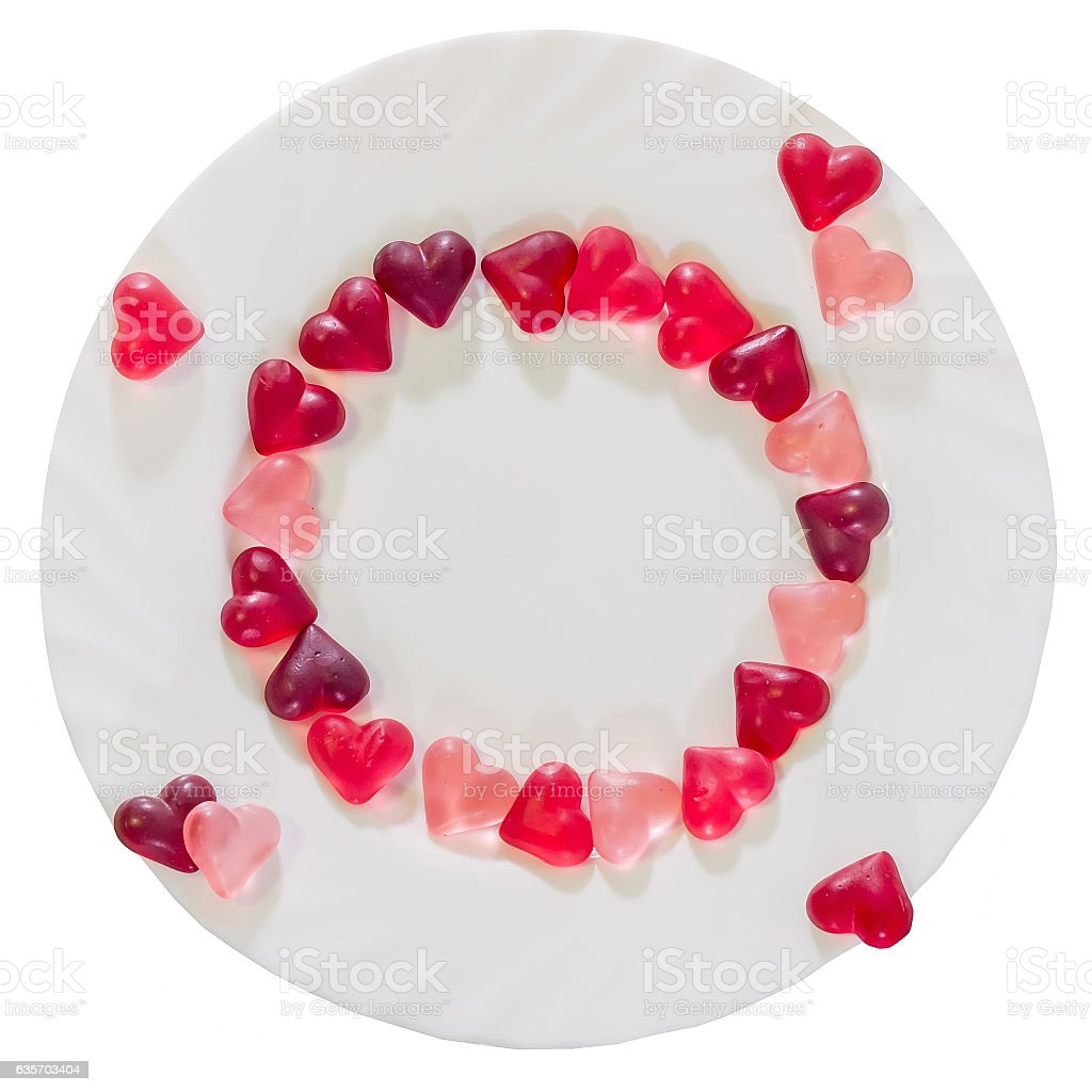 Colored transparent heart shape jellies with ceramic plate royalty-free stock photo