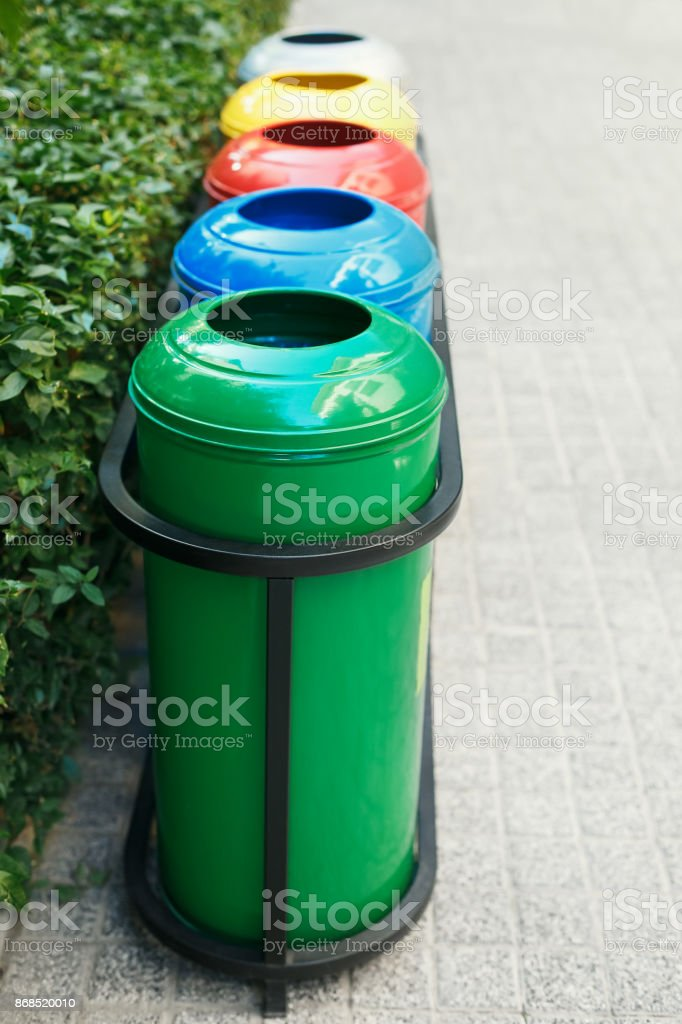 Colored trash containers for garbage separation stock photo