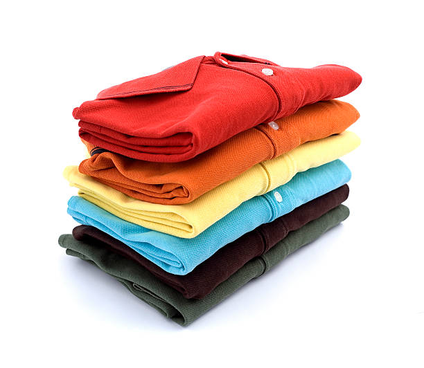 colored t-shirts - folded stock photos and pictures
