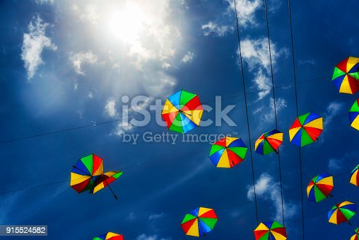 istock Colored umbrellas for dancing Frevo against deep blue sky 915524582