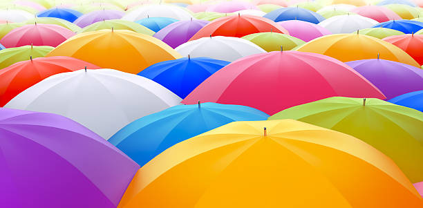 Colored Umbrellas Colored umbrellas. Color full life concept. Colors. cmyk stock pictures, royalty-free photos & images
