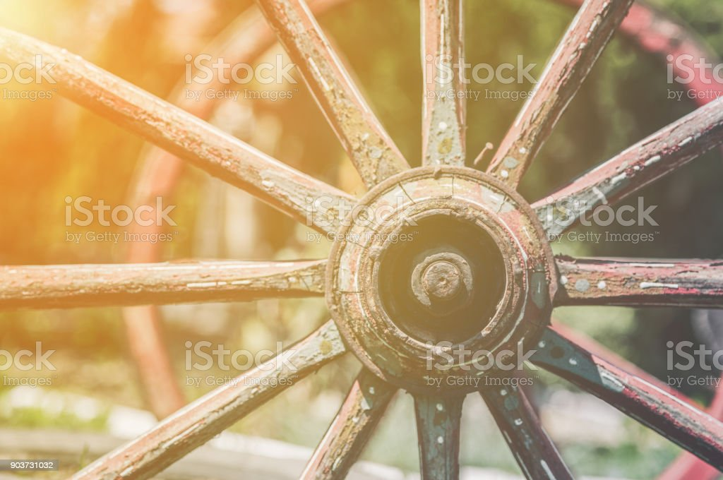 Colored vintage carriage wheels stock photo