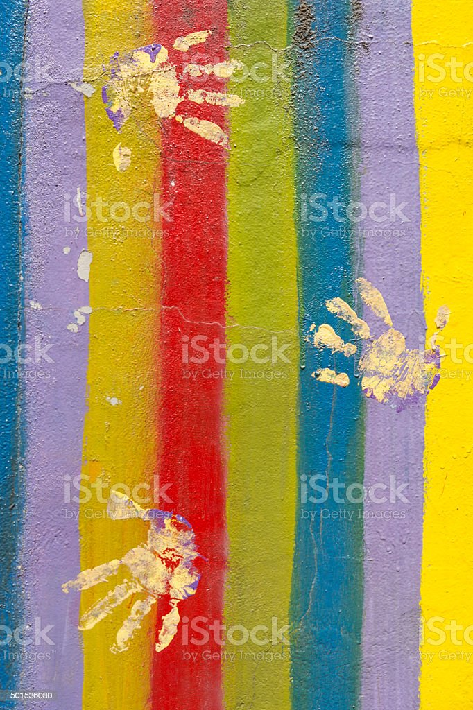 Colored Wall With Hand Prints stock photo