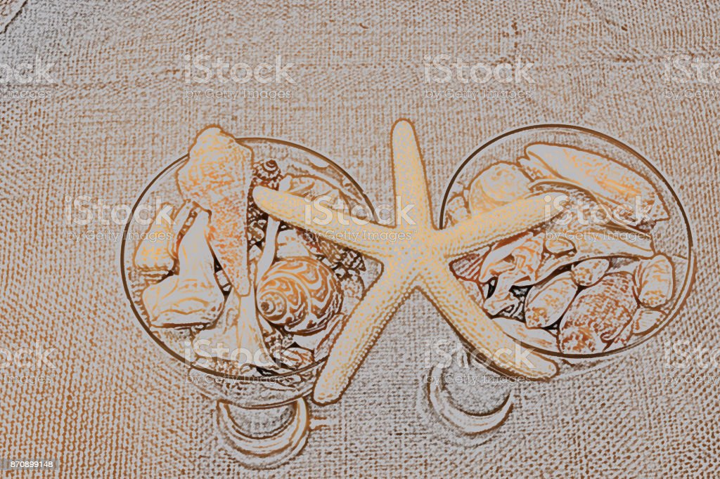 COlored wine glasses filled seashells adn starfish balanced on top stock photo