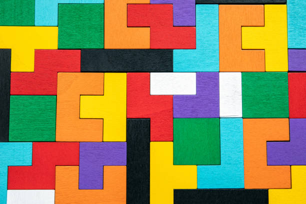 Colored wooden blocks. Puzzle, mind game and toy stock photo