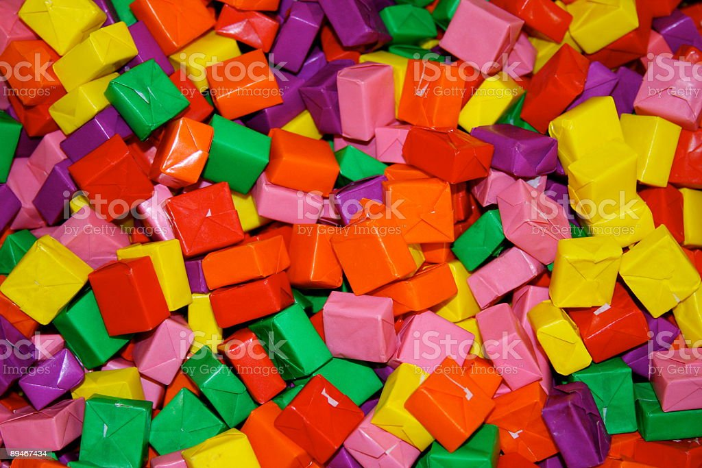 Colored Wrapped Squares Of Chewy Candy Background royalty-free stock photo