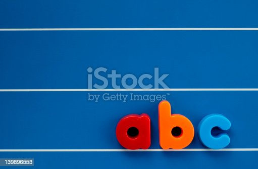 istock Colorful ABC children's magnet on a blue board 139896553