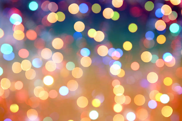 colorful abstract background blur motion with bokeh light - holidays and celebrations stock photos and pictures