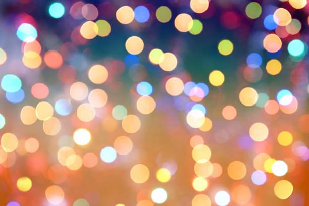 coloré fond flou de mouvement abstrait avec bokeh léger - illumination photos et images de collection