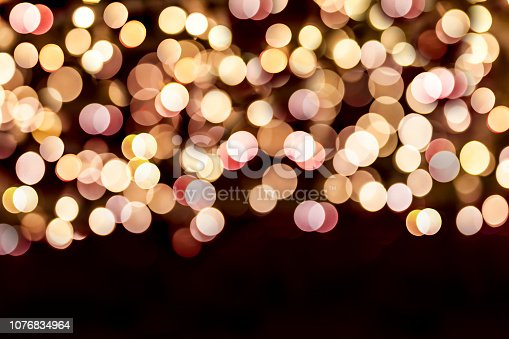 929640504istockphoto Colorful abstract Background with bokeh lights 1076834964