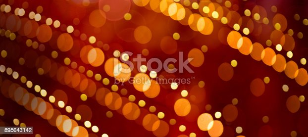 929640504istockphoto Colorful abstract Background with bokeh lights. 895643142