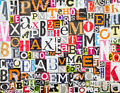 istock Colorful abstract collage from clippings with letters and numbers texture background. Torn and peeling pieces of magazine paper with shabby surface. 1278583120