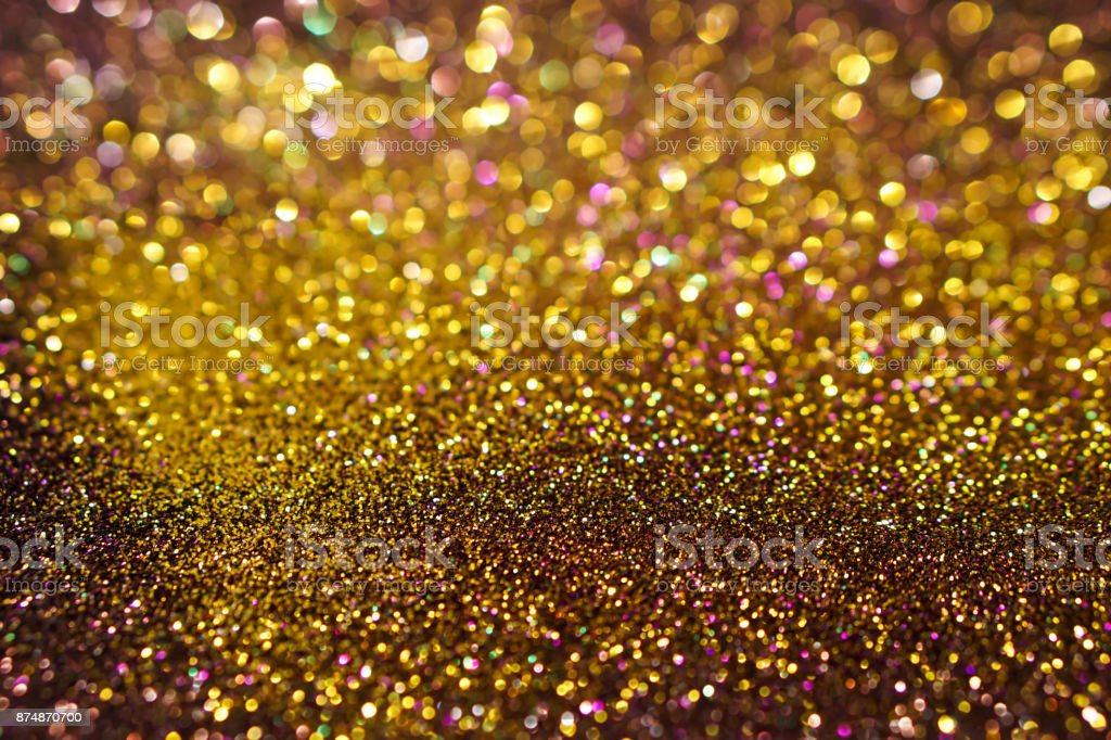 colorful abstract golden and brown bokeh light glitter background for Christmas stock photo