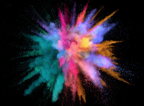 Colorful abstract powder background with color spectrum, isolated on black background