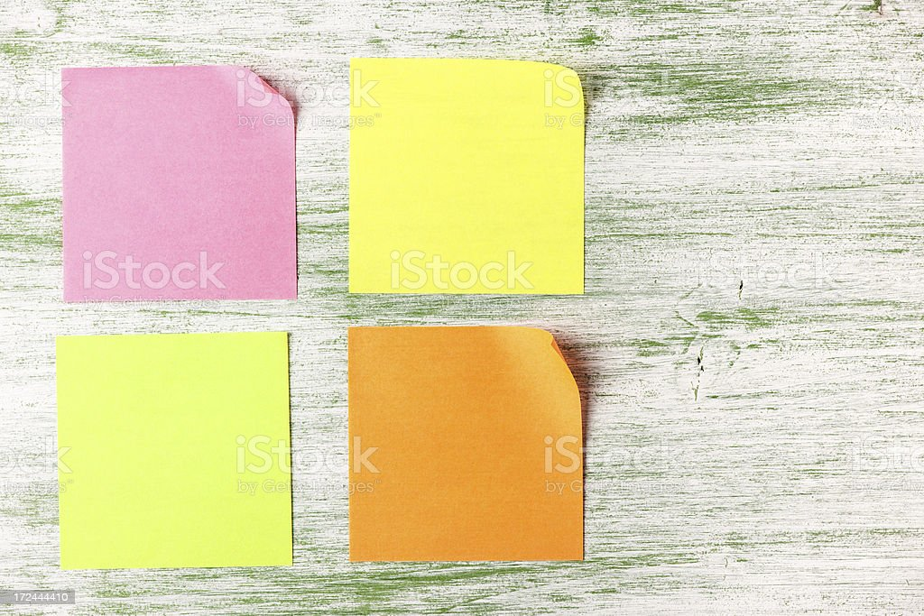 Colorful adhesive notes on painted wood background