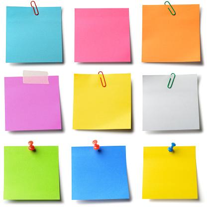 Nine colorful adhesive notes. Isolated on white.