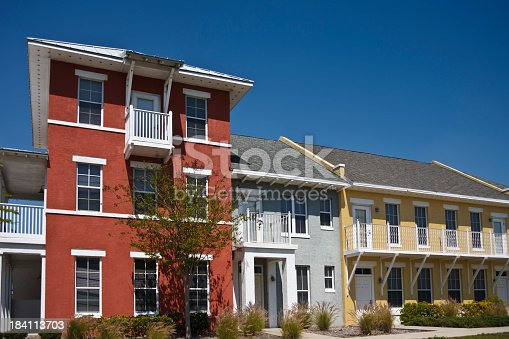 New housing development; affordable housing. A row of condominiums, apartments or townhouses. Low income, public housing.