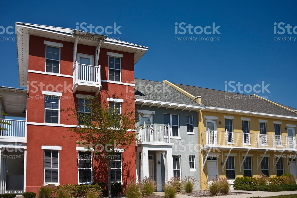 A colorful affordable housing complex under a clear sky stock photo