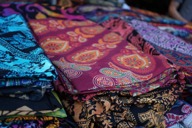 colorful african fabrics - kente cloth stock photos and pictures