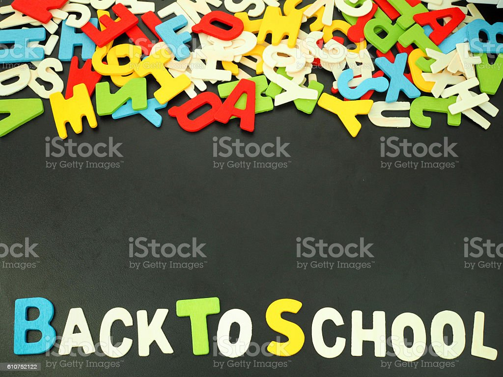 Colorful alphabet back to school on wood background stock photo