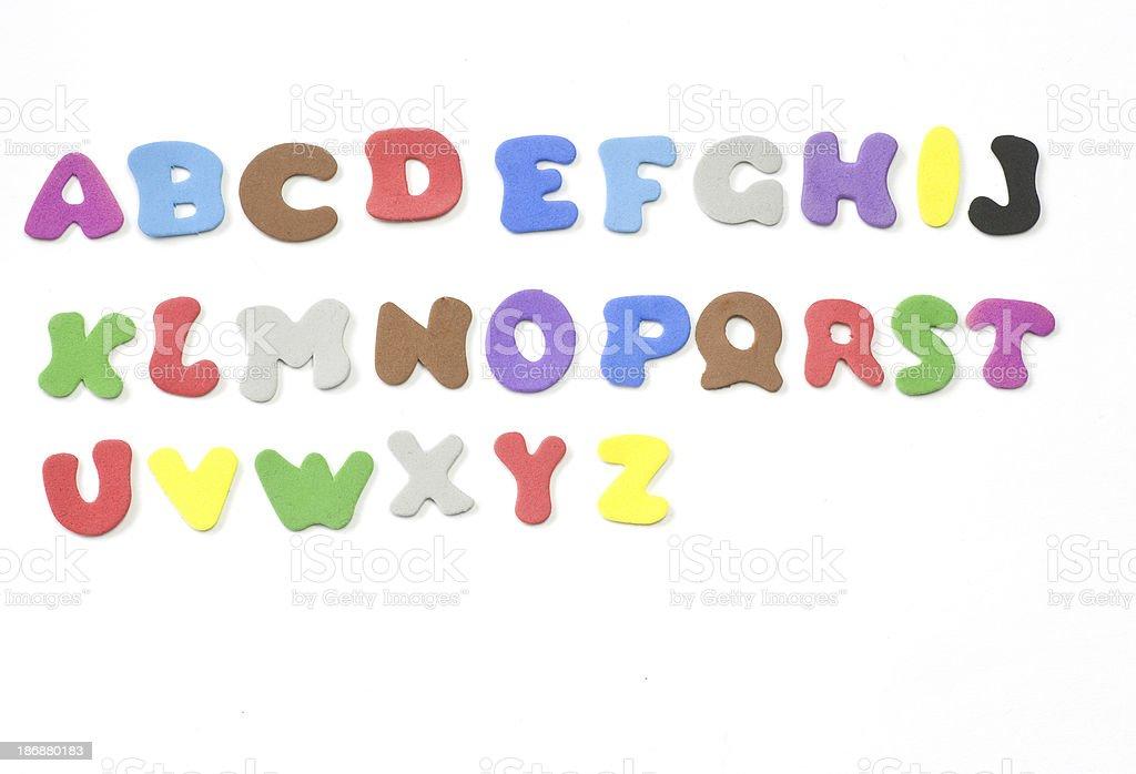 colorful alphabeth auf weißem Hintergrund aus Moosgummi stock photo