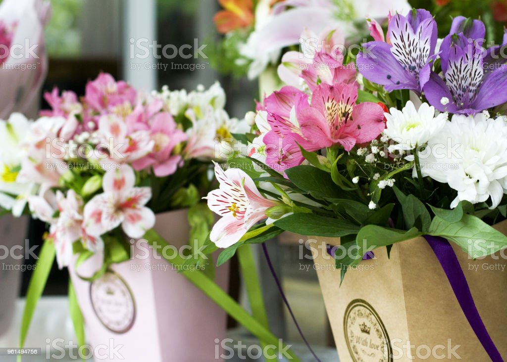 Colorful Alstroemeria flowers. A large bouquet of multi-colored alstroemerias in the flower shop are sold in the form of a gift box. The farmer's market. Close up. stock photo