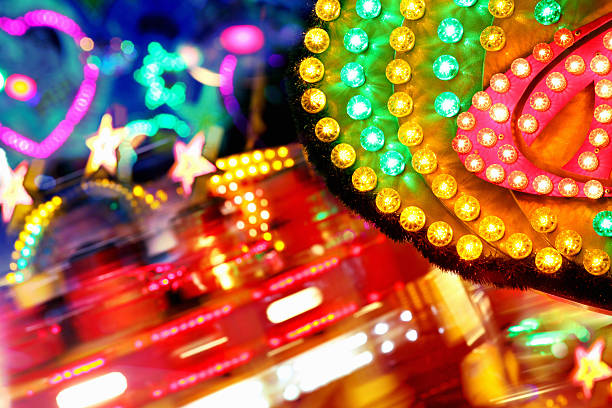 colorful amusement park funfair lighting with vibrant light bulbs background - circus background stock photos and pictures