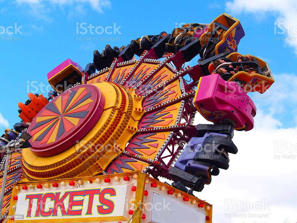 Colorful amusement ride and cabin tickets stock photo