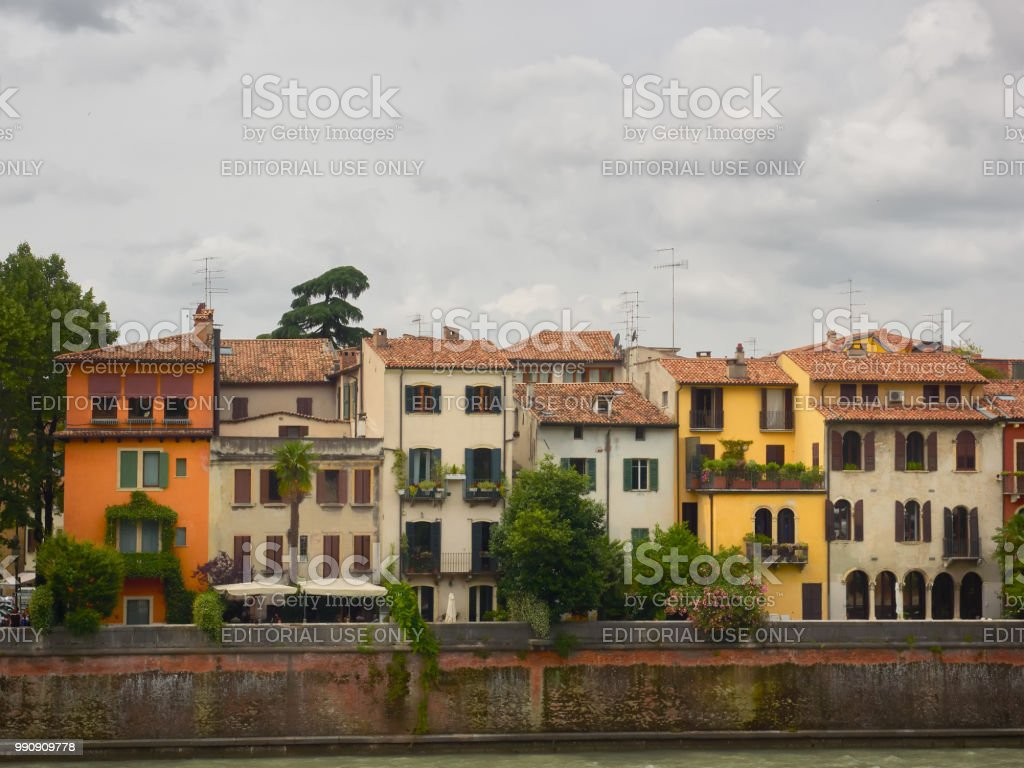 Colorful ancient houses along the Adige River stock photo