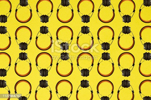 Colorful and abstract headphone pattern on yellow background