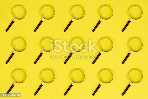 Colorful and abstract magnifying glass pattern on yellow background