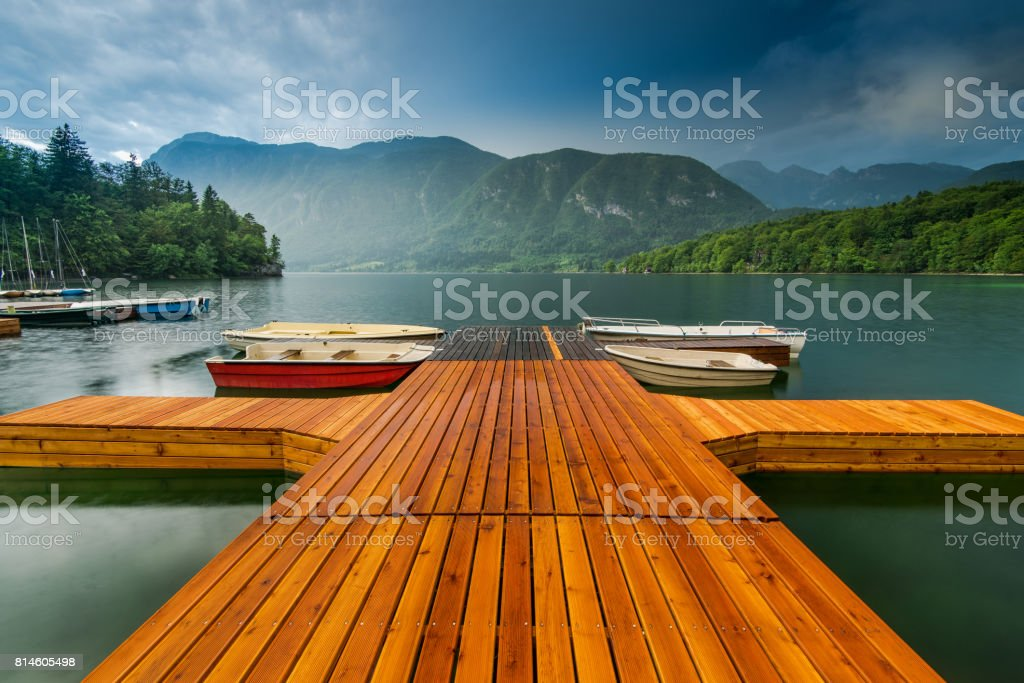 Colorful and artistic wooden pier at Bohinj Lake, Slovenia stock photo