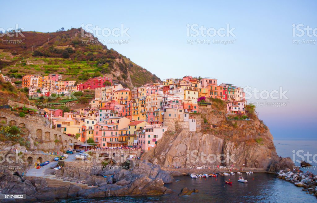 Colorful and beautiful houses, village in Manarola with sunset, Cinque terre Italy famous place. stock photo